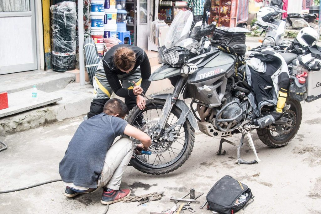 Repairing a flat front tire Indian style.